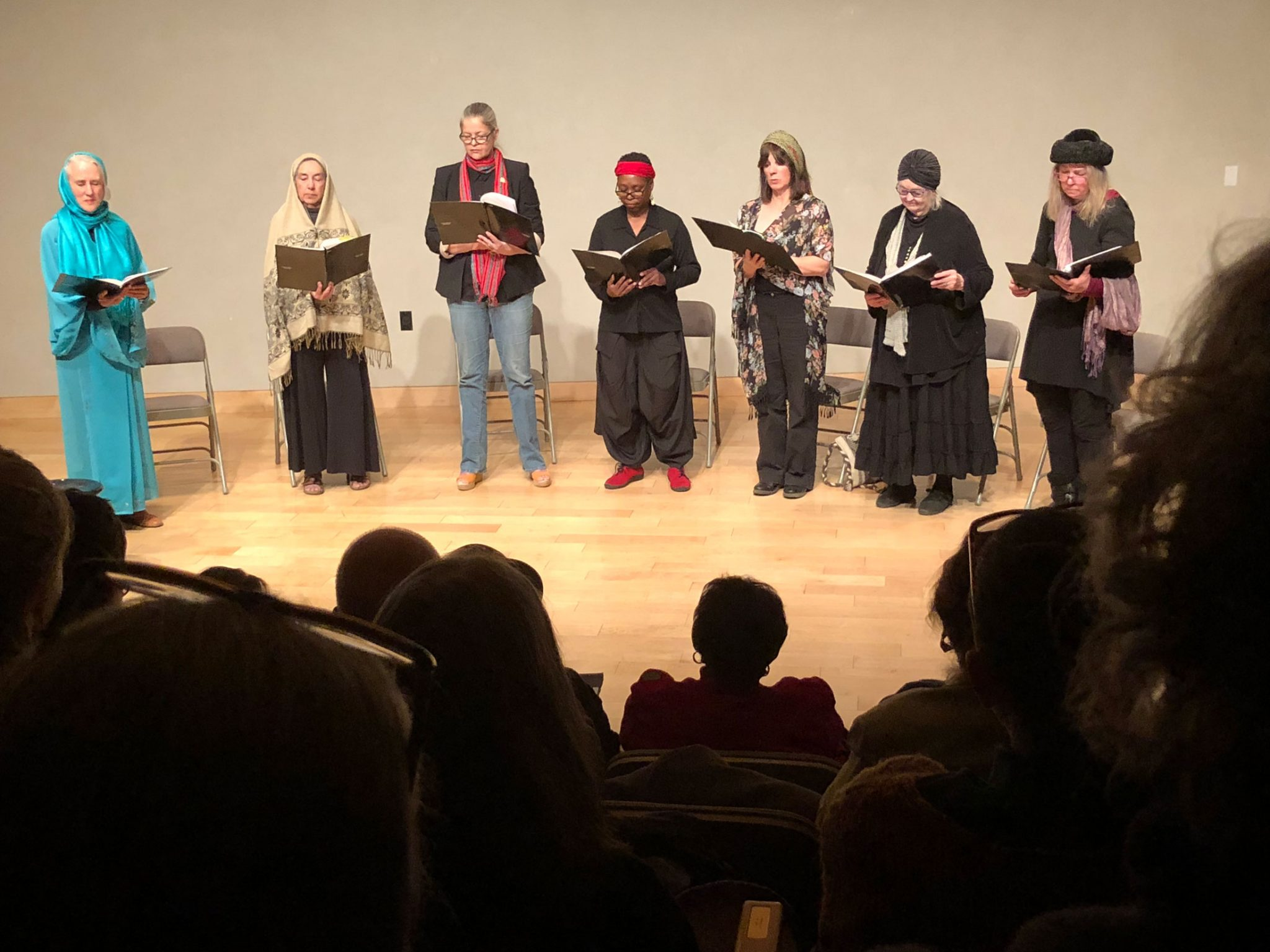 A group of women reading as part of the SOMOS writers showcase